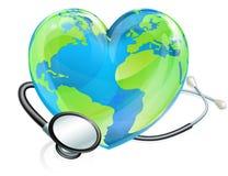 Concepto de la salud del globo del mundo del corazón de la tierra del estetoscopio Imágenes de archivo libres de regalías