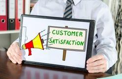 Concepto de la satisfacción del cliente en un tablero fotografía de archivo libre de regalías