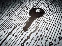 Concepto de la seguridad: placa de circuito con llave Foto de archivo