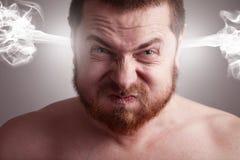 Concepto de la tensión - hombre enojado con la pista de estallido Fotografía de archivo