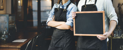 Concepto de la tienda de Barista Staff Working Coffee imagen de archivo