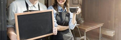 Concepto de la tienda de Barista Staff Working Coffee imagenes de archivo