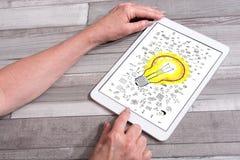 Concepto de las ideas en una tableta imagen de archivo