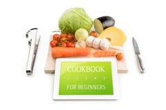 Coocbook para los principiantes con la comida Foto de archivo libre de regalías