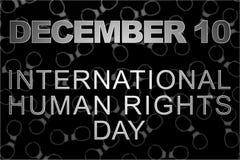Concepto de los derechos humanos: esposas y el texto: Día de los derechos humanos escrito en la pizarra Fotografía de archivo libre de regalías