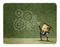 Concepto de negocio, engranajes del dibujo del hombre Foto de archivo