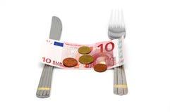 Concepto de ningún dinero para la comida con el dinero y los cubiertos Imagen de archivo