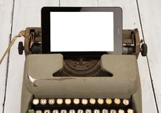 Concepto de progreso de la tecnología - máquina de escribir vieja y nueva tableta p fotos de archivo