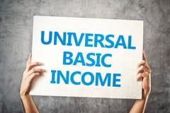 Concepto de renta básico universal Imagen de archivo libre de regalías