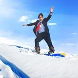 Concepto de Snowboarding Sports Extreme del hombre de negocios Foto de archivo libre de regalías