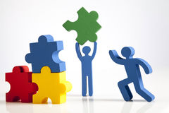Concepto de trabajo en equipo, de gente y de iconos Foto de archivo