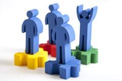 Concepto de trabajo en equipo, de gente y de iconos Foto de archivo libre de regalías