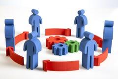 Concepto de trabajo en equipo, de gente y de iconos Fotos de archivo