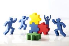 Concepto de trabajo en equipo, de gente y de iconos Imagen de archivo