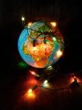 Concepto de una amenaza del efecto de invernadero causado por las lámparas incandescentes Foto de archivo libre de regalías