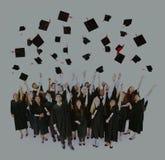 Concepto del éxito de los estudiantes de los adolescentes de la universidad de la graduación Imagen de archivo