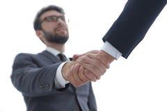 Concepto del éxito en el negocio - apretón de manos de socios Foto de archivo libre de regalías