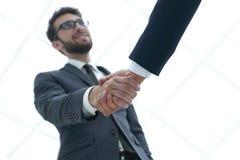 Concepto del éxito en el negocio - apretón de manos de socios Imagen de archivo
