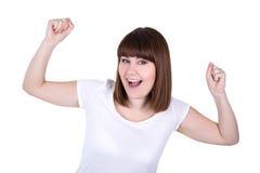 Concepto del éxito - mujer hermosa joven feliz aislada en blanco Foto de archivo libre de regalías