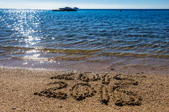 Concepto del Año Nuevo en la playa del mar Imágenes de archivo libres de regalías