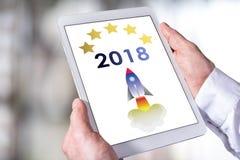 Concepto 2018 del Año Nuevo en una tableta Imágenes de archivo libres de regalías