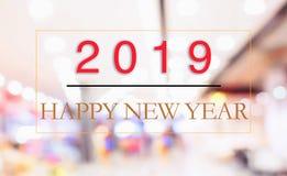 Concepto del Año Nuevo 2019: Feliz Año Nuevo 2019 en fondo abstracto del bokeh de la falta de definición foto de archivo