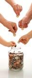 Concepto del ahorro con las manos de diversas generaciones Imagen de archivo