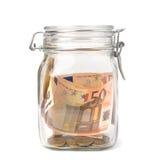 Concepto del asunto. Ahorros del dinero en el crisol de cristal. Foto de archivo libre de regalías