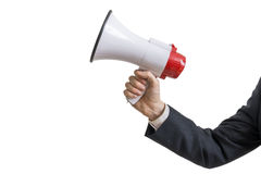 Concepto del aviso La mano sostiene el megáfono Aislado en el fondo blanco foto de archivo libre de regalías