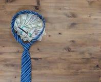Concepto del caballero Lazo y dólares Imagen de archivo libre de regalías