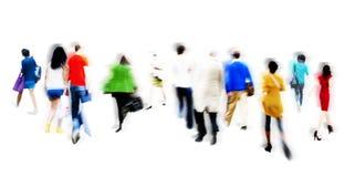 Concepto del consumidor de la venta del mercado al por menor de la gente que hace compras que camina Foto de archivo libre de regalías