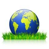 Concepto del día del ambiente mundial Globo de la tierra en vector de la hierba verde Imagenes de archivo