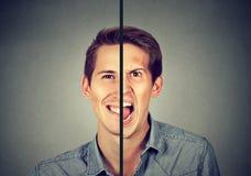 Concepto del desorden bipolar Hombre joven con la expresión doble de la cara fotografía de archivo