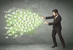 Concepto del dinero de la persona joven del negocio que lanza Imagen de archivo