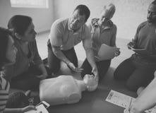 Concepto del entrenamiento de los primeros auxilios del CPR Fotos de archivo libres de regalías