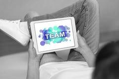 Concepto del equipo en una tableta foto de archivo libre de regalías