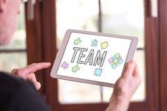 Concepto del equipo en una tableta fotografía de archivo libre de regalías