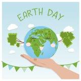 Concepto del fondo del Día de la Tierra Diseño plano del ejemplo manos que sostienen un globo con los edificios y los árboles imagenes de archivo
