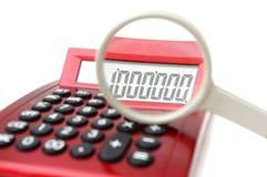 Concepto del fraude con la lupa, calculadora Imágenes de archivo libres de regalías