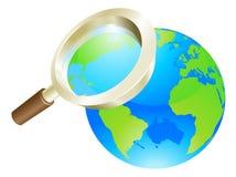 Concepto del globo de la tierra del mundo de la lupa Imágenes de archivo libres de regalías