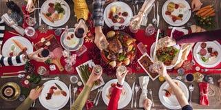 Concepto del grupo de la cena del Año Nuevo de la Navidad Fotografía de archivo libre de regalías