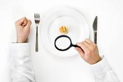 Concepto del hambre y de la dieta. Imagenes de archivo