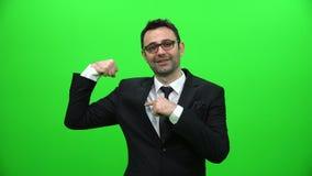 Concepto del hombre de negocios Shows His Muscles, de la fuerza y del poder almacen de video
