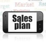 Concepto del márketing: Smartphone con plan de las ventas en la exhibición Imagen de archivo libre de regalías