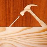 Concepto del martillo y del clavo en madera Fotos de archivo