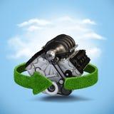 Concepto del motor del motor del coche con las flechas verdes de la hierba Reciclaje de concepto en fondo azul Imagen de archivo libre de regalías