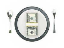 Concepto del negocio - billetes de banco de la placa, de los cubiertos y del dólar Imagen de archivo libre de regalías