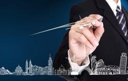 Concepto del negocio del viaje de la escritura del hombre de negocios Imagen de archivo libre de regalías