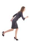 Concepto del negocio - mujer en el funcionamiento del vestido aislada en blanco Fotografía de archivo