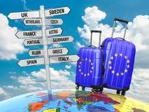 concepto del recorrido Maletas y poste indicador qué a visitar en Europa Imágenes de archivo libres de regalías